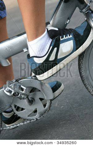 Boy's sneakers and bicycle pedals