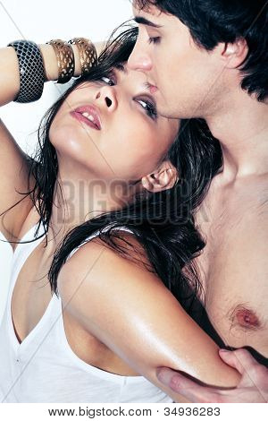 Young woman standing close to the guy to arouse him