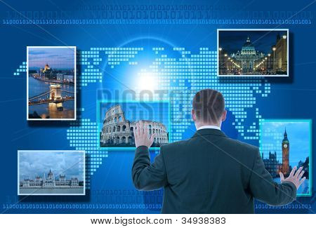 Businessman looking for tourism information using futuristic touch interface