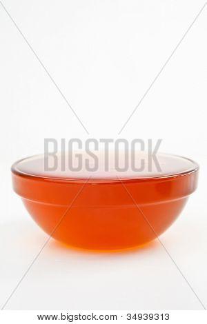 Honey full bowl against a white background