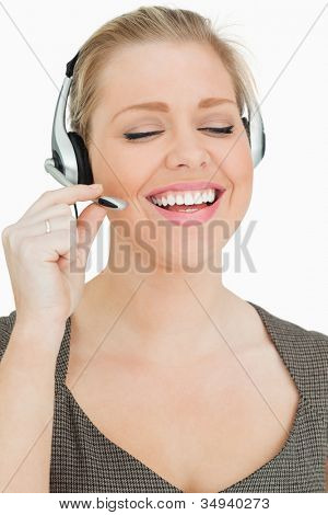 Woman speaking with her headset against white background