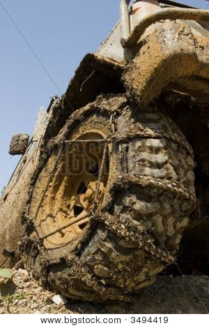 Muddy Wheel Close-Up On A Vehicle Participating In Off-Road Challenge