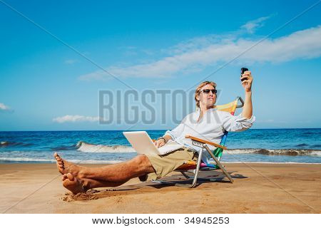 Young Business Man Working Remotely on Tropical Beach