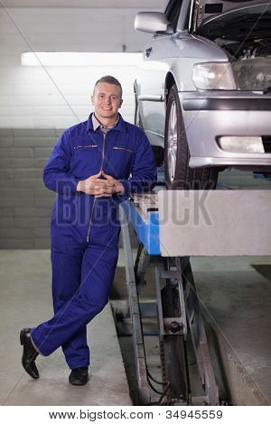 Front view of a mechanic in a garage