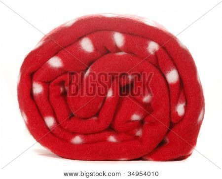 Red blanket with white spots