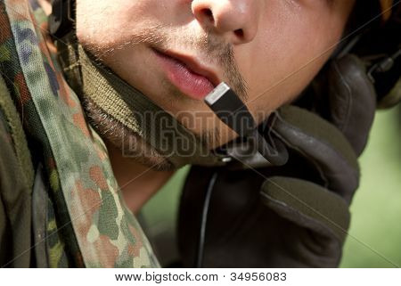 Soldier Talking On A Headset
