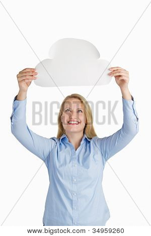 Female Holding A Paper Cloud And Smiling