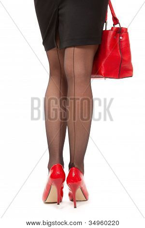 Beautiful Lady Long Legs On High Heels And Red Handbag Over White