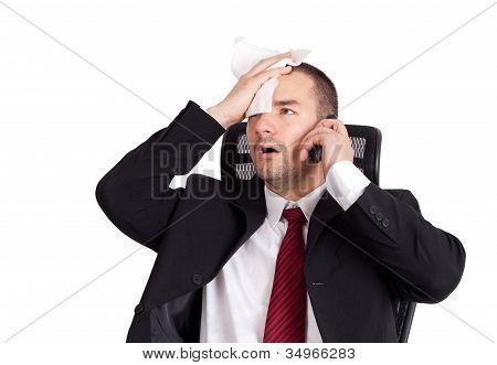 Businessman Holding Forehead