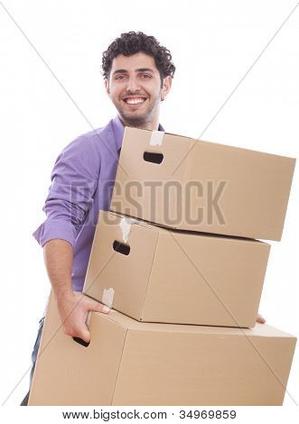 Young and handsome guy carrying boxes over white background