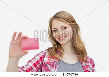 Woman holding a loyalty card against a white background