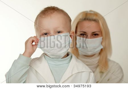 Child And Medical Doctor In Mask