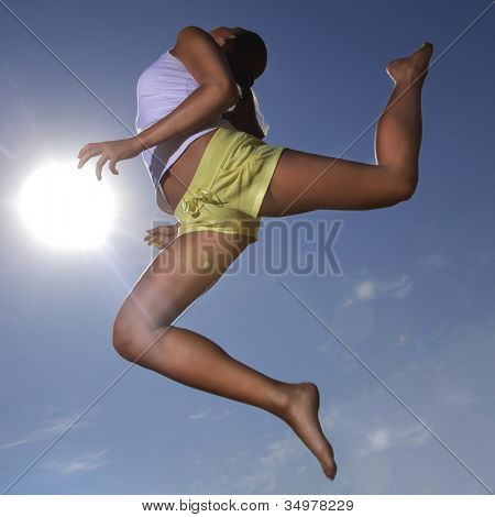 beauty girl jumping on summer beach