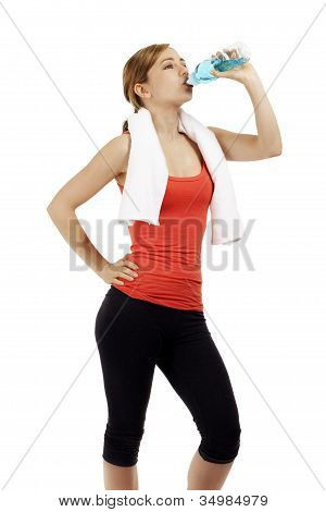 cute young fitness woman drinking water