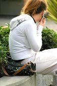 picture of hustler  - female using cellphone    - JPG
