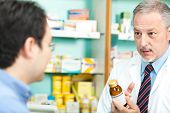 picture of erectile dysfunction  - Senior pharmacist dealing with a customer - JPG