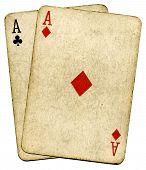 stock photo of playing card  - Old vintage dirty aces cards isolated over white - JPG