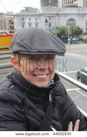 A mature woman wearing a flat cap