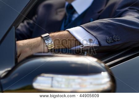 Hand Of Businessman In Cabrio