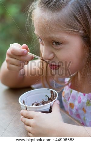 Funny Little Girl Eats Ice-cream
