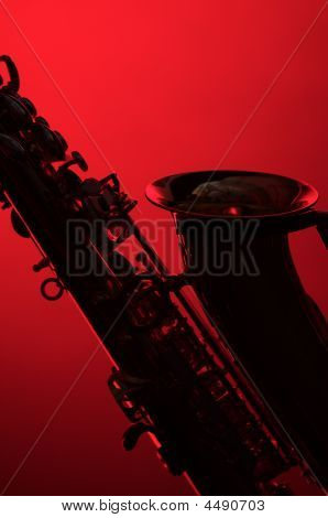 Saxophone Silhouette On Red