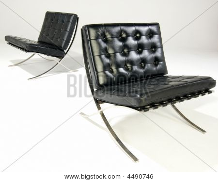 two bacelona chairs