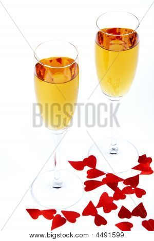 Two Wine Glasses And Red Hearts