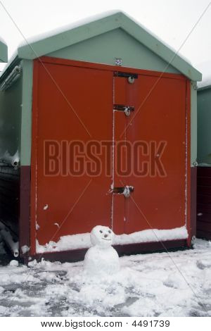 Beach Hut Guarded By Snowman