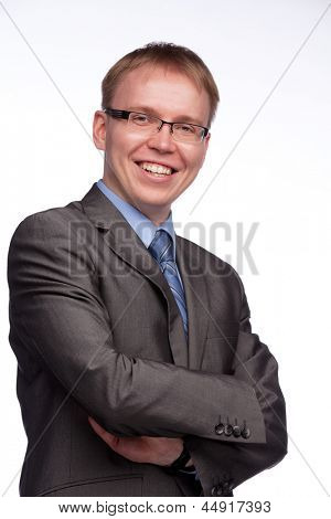 Young handsome man in grey suit and glasses smiling isolated on white background