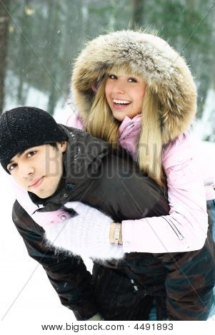 Young Couple Having Fun In Winter Park