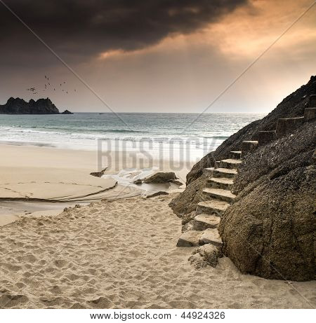 Stairs carved into rock on beautiful secluded beach
