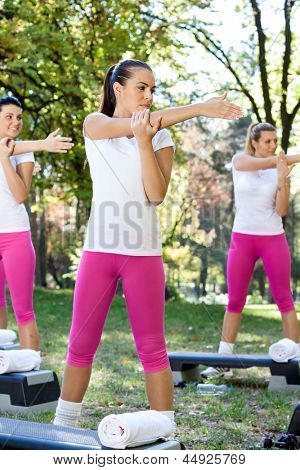 group of young women doing workout, outdoor