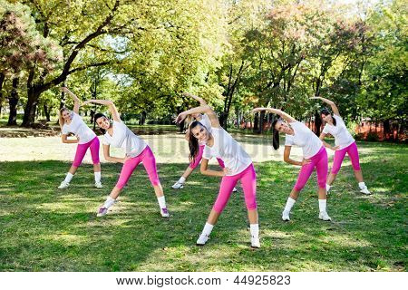 Group of six woman doing stretching exercise