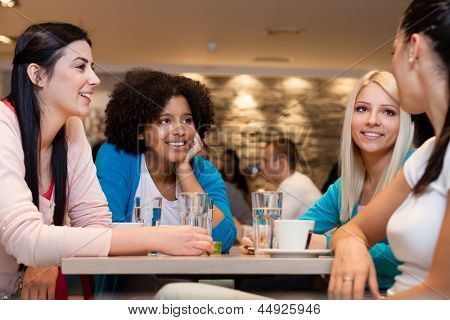 Four  young women having coffee break