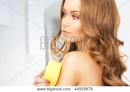 bright picture of beautiful woman with sponge