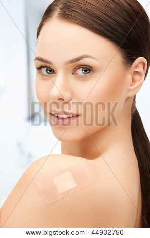 portrait of beautiful woman with medical patch or plaster
