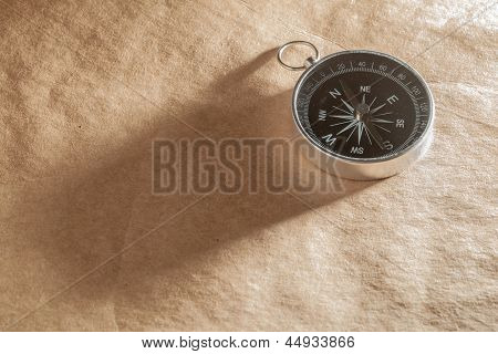 Compass On Light Brown Background