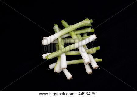 Fresh Baby Leek On Black Background