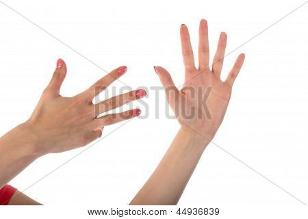 Female Hands Showing Nine Fingers Isolated On White Background