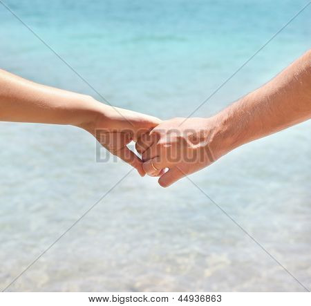 Young Couple In Love Holding Hands