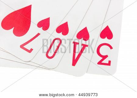 Cards Spelling The Word Love On White