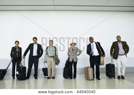 People waiting at airport with luggage