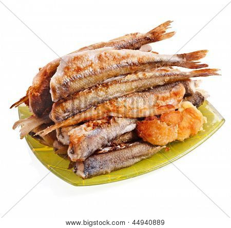 fried smelts Baltic fish on a dish isolated on white background