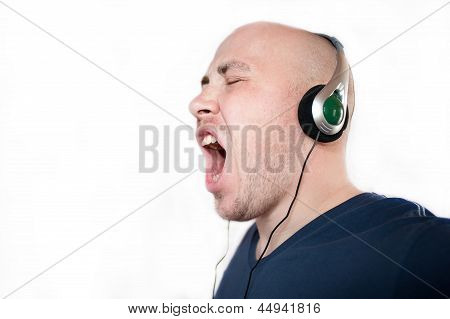 emotional man listens to music