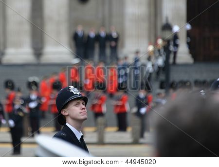 LONDON - UK, APRIL 17: Policeman lining Baroness Thatcher procession route on Ludgate Hill, on April 17, 2013 in London.