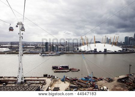 LONDON, UK - APRIL 15: O2 or Millenium Dome seen from the Emirates cable car. The service is London's first urban cable car which crosses the Thames  on April 15, 2013 in London UK