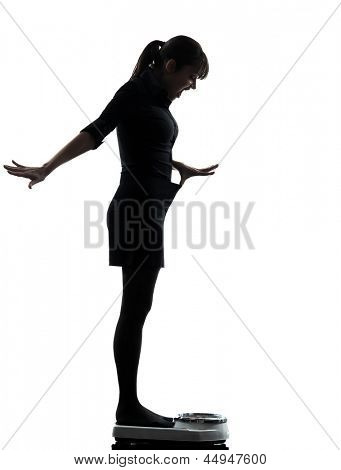 one woman standing on weight scale happy silhouette studio isolated on white background