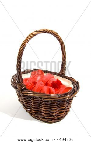 Wicker Basket Filled With Red Rose Peddles