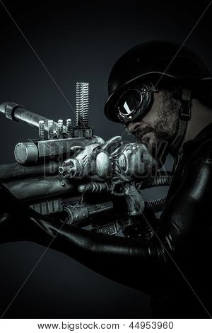 soldier of the future with huge laser gun and cannon, pointing