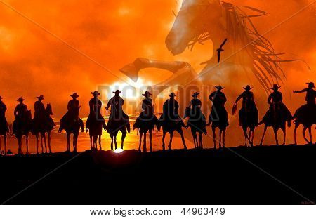 Cowboys riding off into the sunset